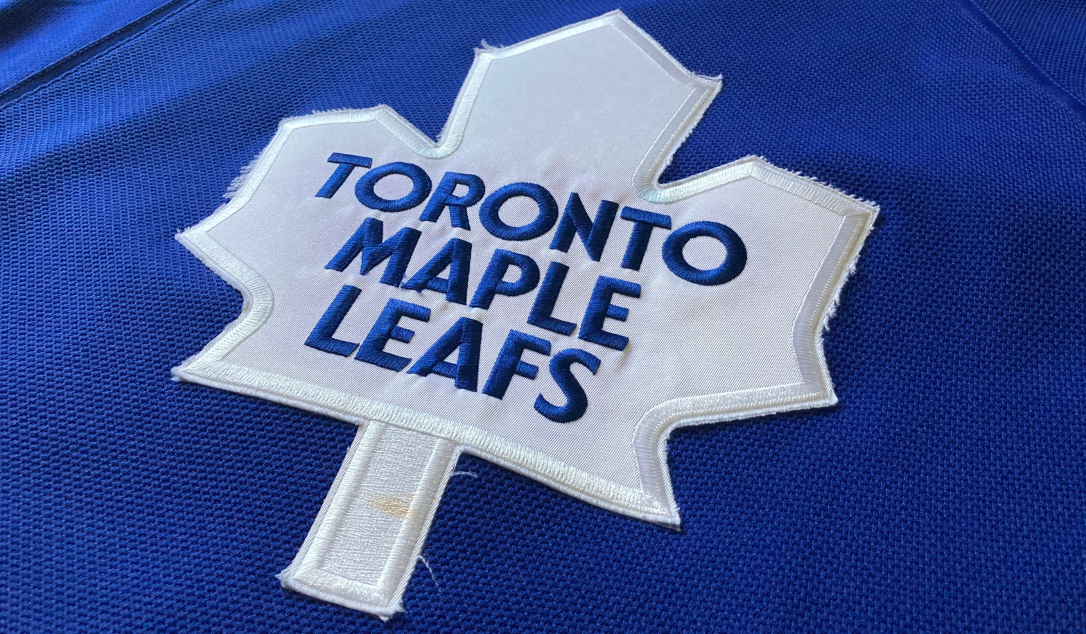 The logo of the Toronto Maple Leafs on the front of a jersey