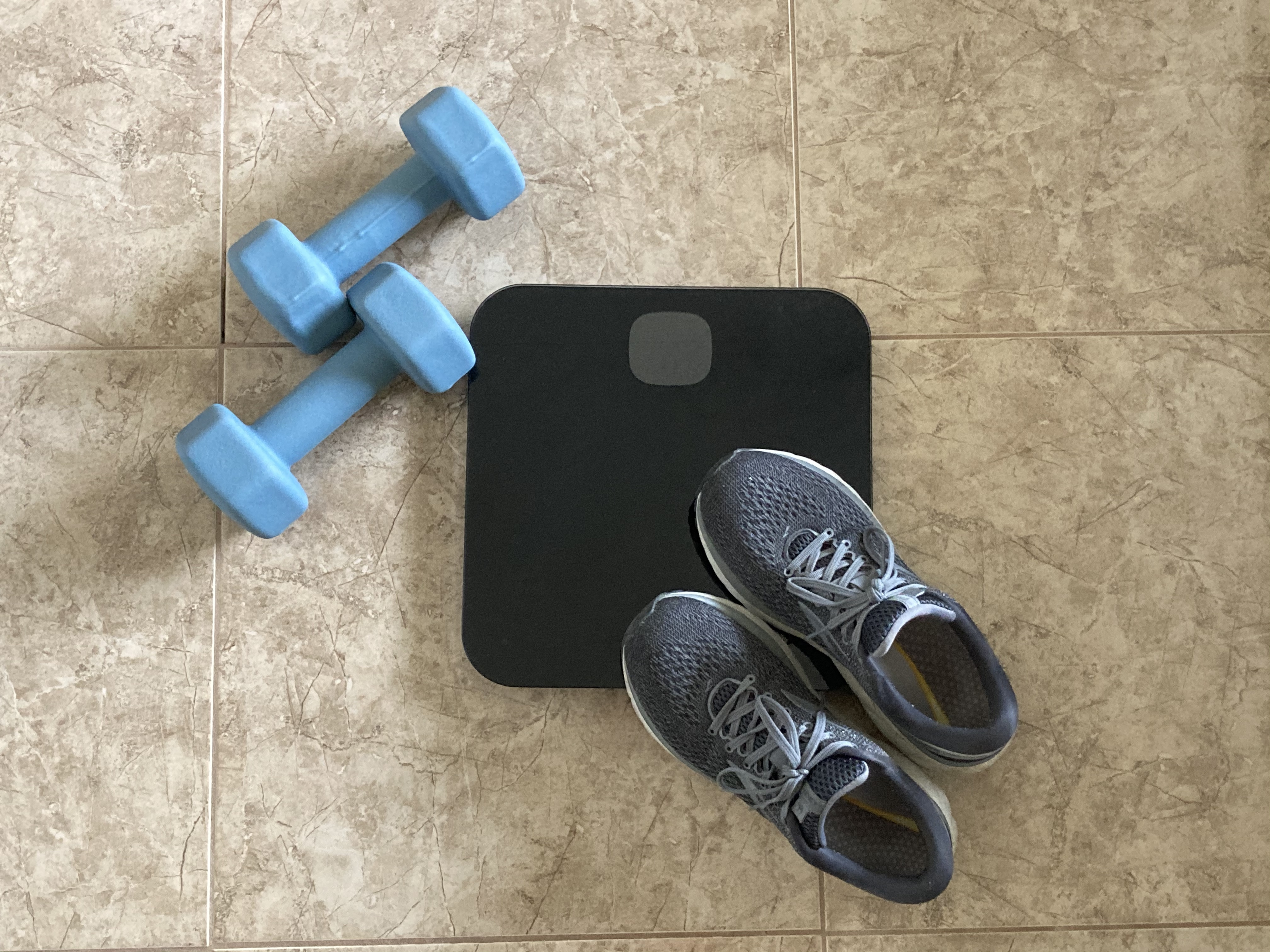 Getting back on track with my fitness goals, showing my scale and dumbbells.